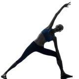 Silueta de la yoga de la actitud de la puerta del parighasana de la mujer Foto de archivo libre de regalías