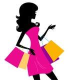 Silueta de las compras de la mujer aislada en blanco Imagen de archivo