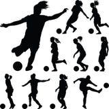Silueta de las mujeres del fútbol jugador de la muchacha Fotos de archivo