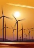 Silueta de las turbinas de viento Fotos de archivo libres de regalías