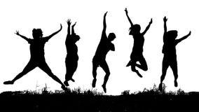 Silueta de los amigos que saltan aislada en el fondo blanco Imagen de archivo