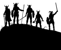 Silueta de los asaltantes entrenados para la lucha cuerpo a cuerpo de Viking Fotografía de archivo