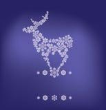 Silueta de los ciervos stanging formados por los copos de nieve Imagen de archivo