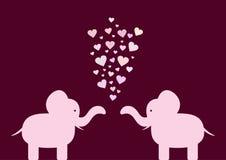 Silueta de los elefantes de los amantes con los corazones Imagen de archivo