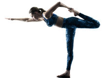 Silueta de los excercises de la yoga de la aptitud de la mujer Fotografía de archivo