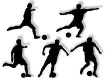Silueta de los futbolistas Imagen de archivo libre de regalías
