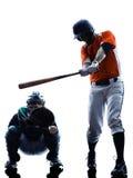 Silueta de los jugadores de béisbol de los hombres aislada Imagen de archivo libre de regalías