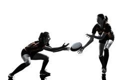 Silueta de los jugadores de las mujeres del rugbi Foto de archivo