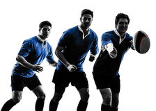 Silueta de los jugadores de los hombres del rugbi Imagen de archivo