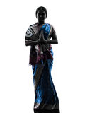 Silueta de rogación que saluda de la mujer india Foto de archivo libre de regalías