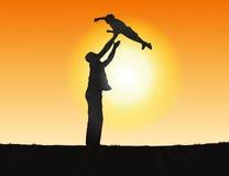 Silueta de un padre y de un niño Imagen de archivo