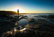 Silueta de un pescador Imagen de archivo libre de regalías