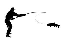 Silueta de un pescador con los pescados de color salmón Fotografía de archivo