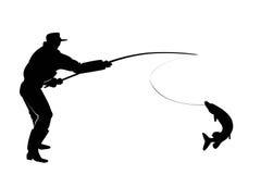 Silueta de un pescador con un pescado del lucio Foto de archivo libre de regalías