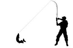 Silueta de un pescador con un pescado del lucio Imagen de archivo
