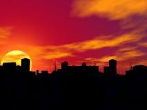 Silueta de una ciudad en puesta del sol. Imagen de archivo