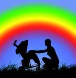 Silueta de una mujer con un cochecito de bebé en un fondo del arco iris Imagen de archivo libre de regalías