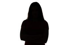 Silueta del adolescente con los brazos cruzados Fotos de archivo libres de regalías