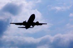 Silueta del aeroplano imagenes de archivo