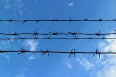 Silueta del alambre de púas Imagen de archivo