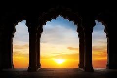 Silueta del arco en la puesta del sol Foto de archivo libre de regalías