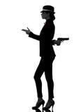 Silueta del asesino del gángster del arma de la mujer Imágenes de archivo libres de regalías