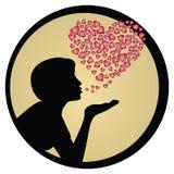 Silueta del beso de la muchacha que sopla Foto de archivo libre de regalías