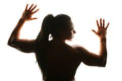Silueta del bodybuilder de la mujer de la parte posterior Imagen de archivo libre de regalías