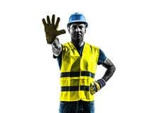 Silueta del chaleco de la seguridad del gesto de la parada del trabajador de construcción foto de archivo