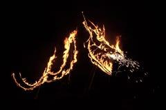 Silueta del dragón en fuego Fotografía de archivo libre de regalías