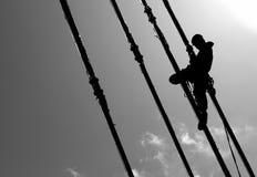 Silueta del escalador de la construcción imagen de archivo libre de regalías