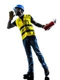 Silueta del extintor del trabajador de construcción Foto de archivo libre de regalías