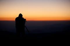 Silueta del fotógrafo Imagen de archivo libre de regalías