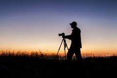 Silueta del fotógrafo Foto de archivo libre de regalías