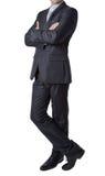 Silueta del hombre de negocios en el traje negro que se coloca derecho puesto Fotografía de archivo