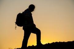 Silueta del hombre en puesta del sol Fotografía de archivo libre de regalías