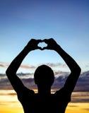 Silueta del hombre en puesta del sol Imagen de archivo libre de regalías