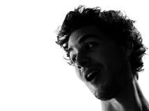 Silueta del hombre joven surpised Foto de archivo libre de regalías