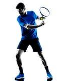 Silueta del hombre que juega al jugador de tenis Fotografía de archivo
