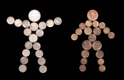 Silueta del hombre y de la mujer de monedas Foto de archivo libre de regalías
