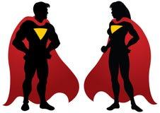 Silueta del hombre y de la mujer del super héroe Fotos de archivo libres de regalías