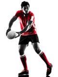 Silueta del jugador del hombre del rugbi aislada Fotos de archivo libres de regalías