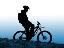 Silueta del motorista Imagen de archivo libre de regalías