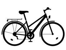 Silueta del negro de la bici de la señora Imagen de archivo libre de regalías