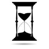 Silueta del negro del reloj de arena de la arena - ejemplo Imagen de archivo