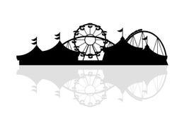 Silueta del parque de atracciones Imagen de archivo libre de regalías