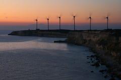 Silueta del parque eólico Imagenes de archivo