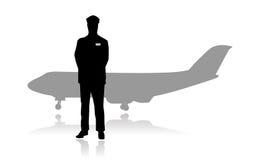 Silueta del piloto o del aviador de la línea aérea del jet Fotos de archivo