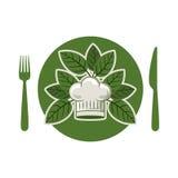 Silueta del plato con las hojas y el sombrero de los cubiertos y del cocinero redondeado Fotografía de archivo