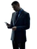 Silueta del teléfono del hombre de negocios aislada Fotos de archivo
